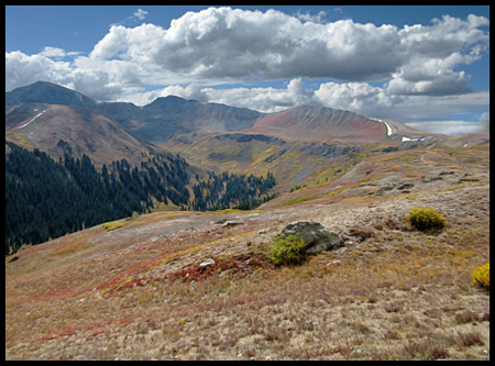 The pass crosses the ridge of the Sawatch Range between Aspen and Leadville, on the border between Pitkin and Lake counties