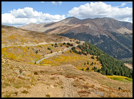 The road is narrow and steep with a 6.5% gradient, including tight switchbacks on each approach. Sections of the pass have a speed limit of 25 mph, with advisory limits on some switchbacks as low as 10 mph.